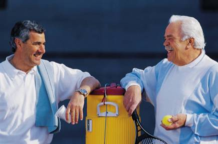 Men enjoying a friendly tennis match on our indoor tennis courts